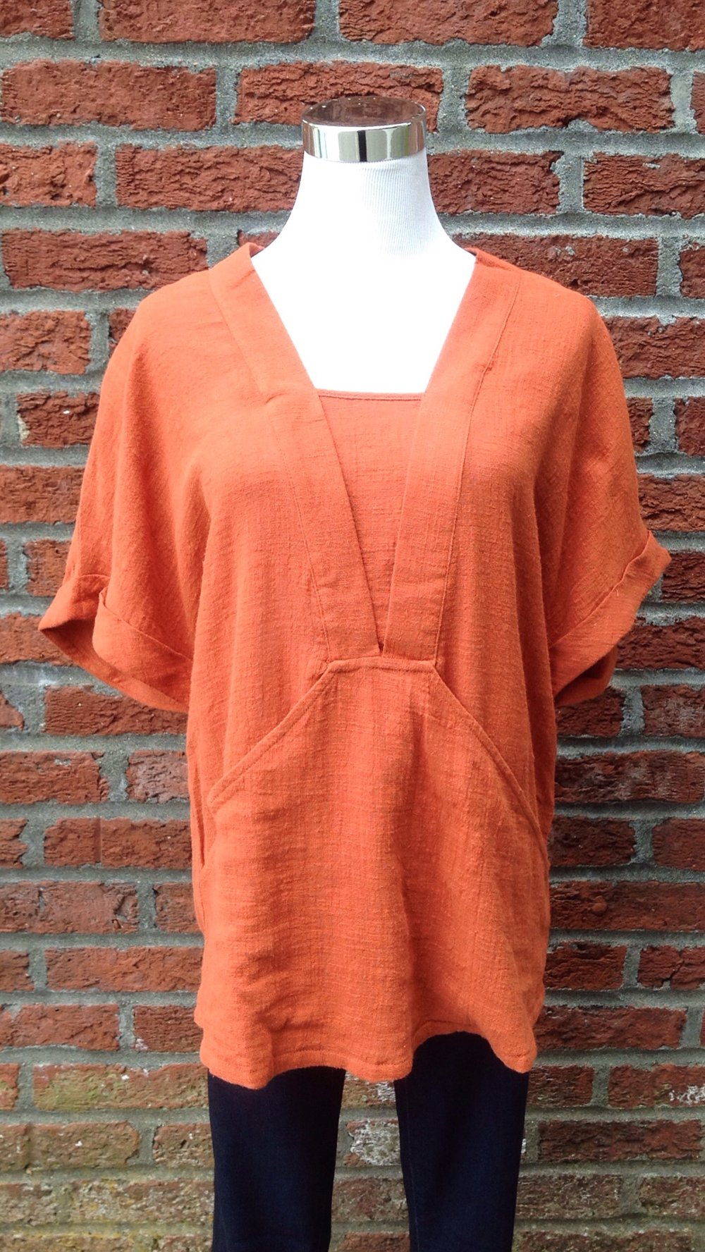 Cotton tunic tee with front pockets, $34