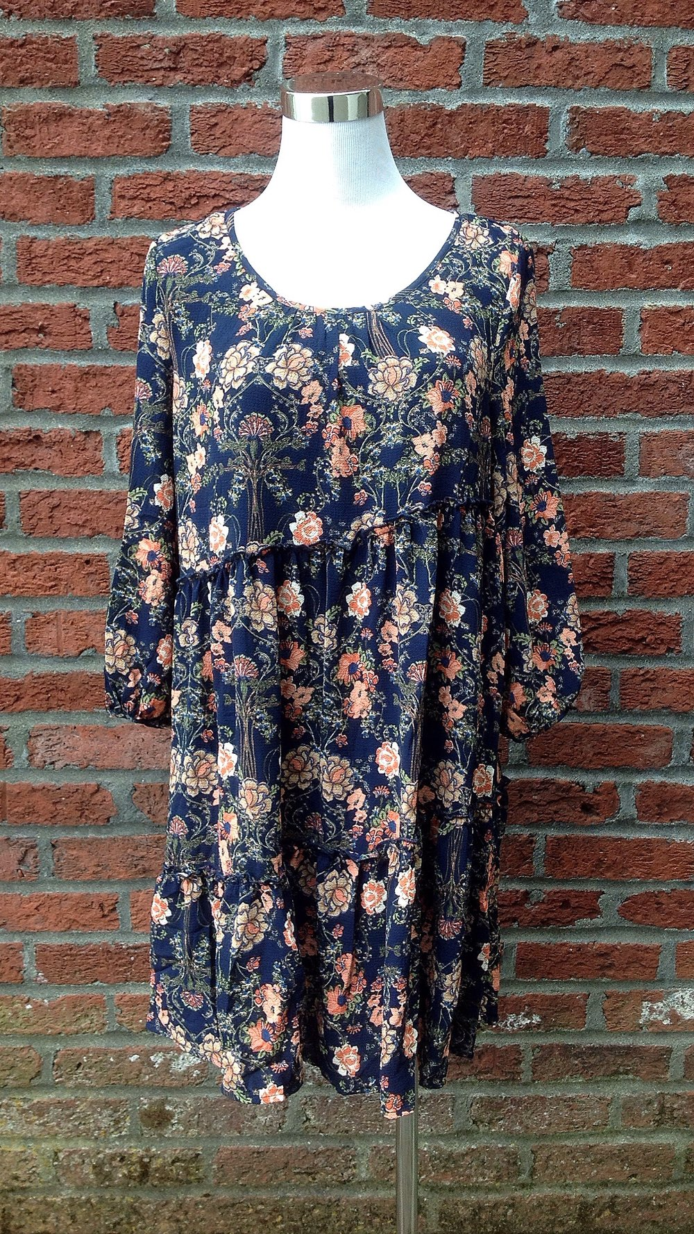 Navy floral babydoll dress with 3/4 sleeves, $42
