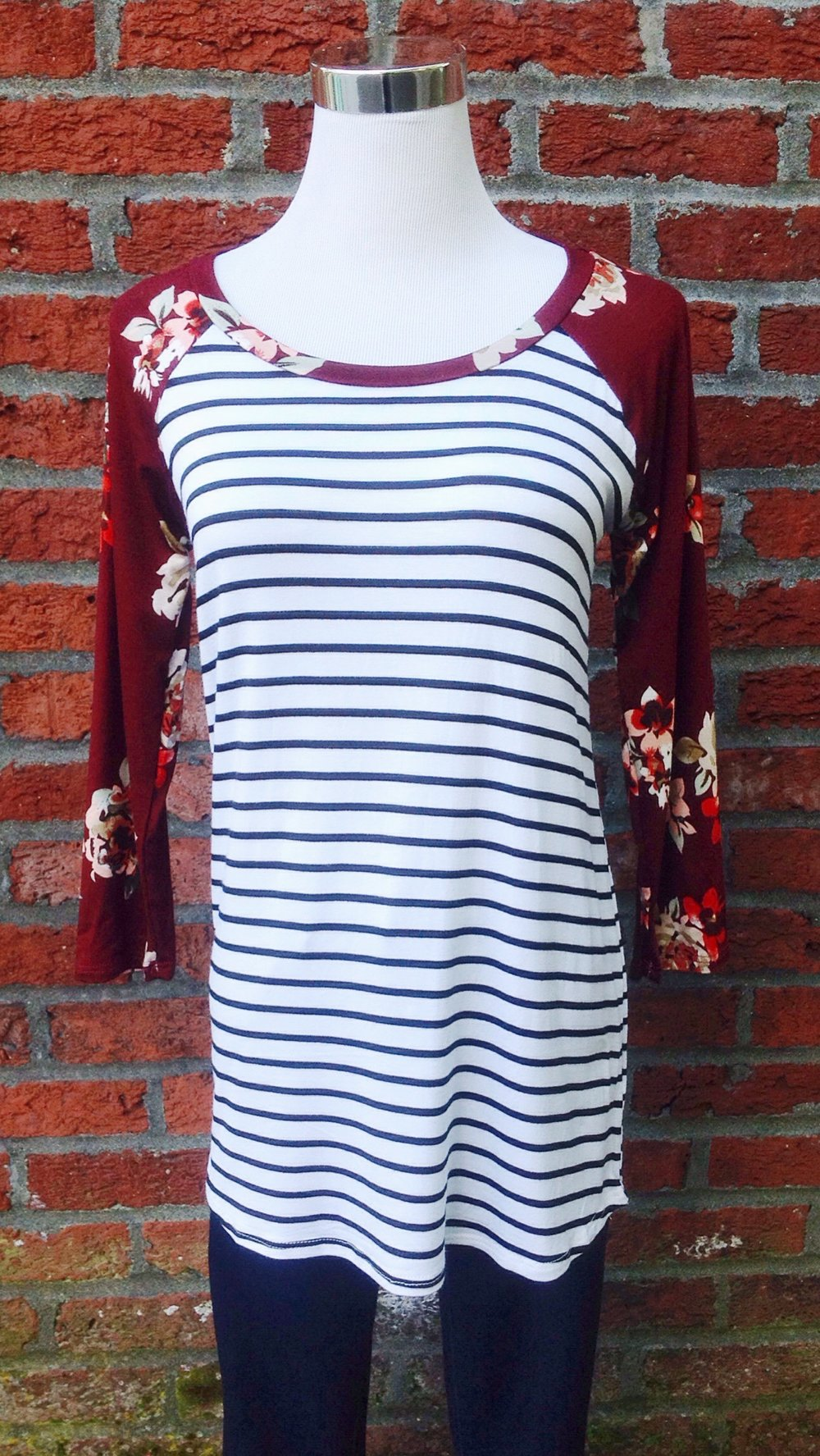 Stripe jersey knit baseball top with contrasting floral sleeves, $28