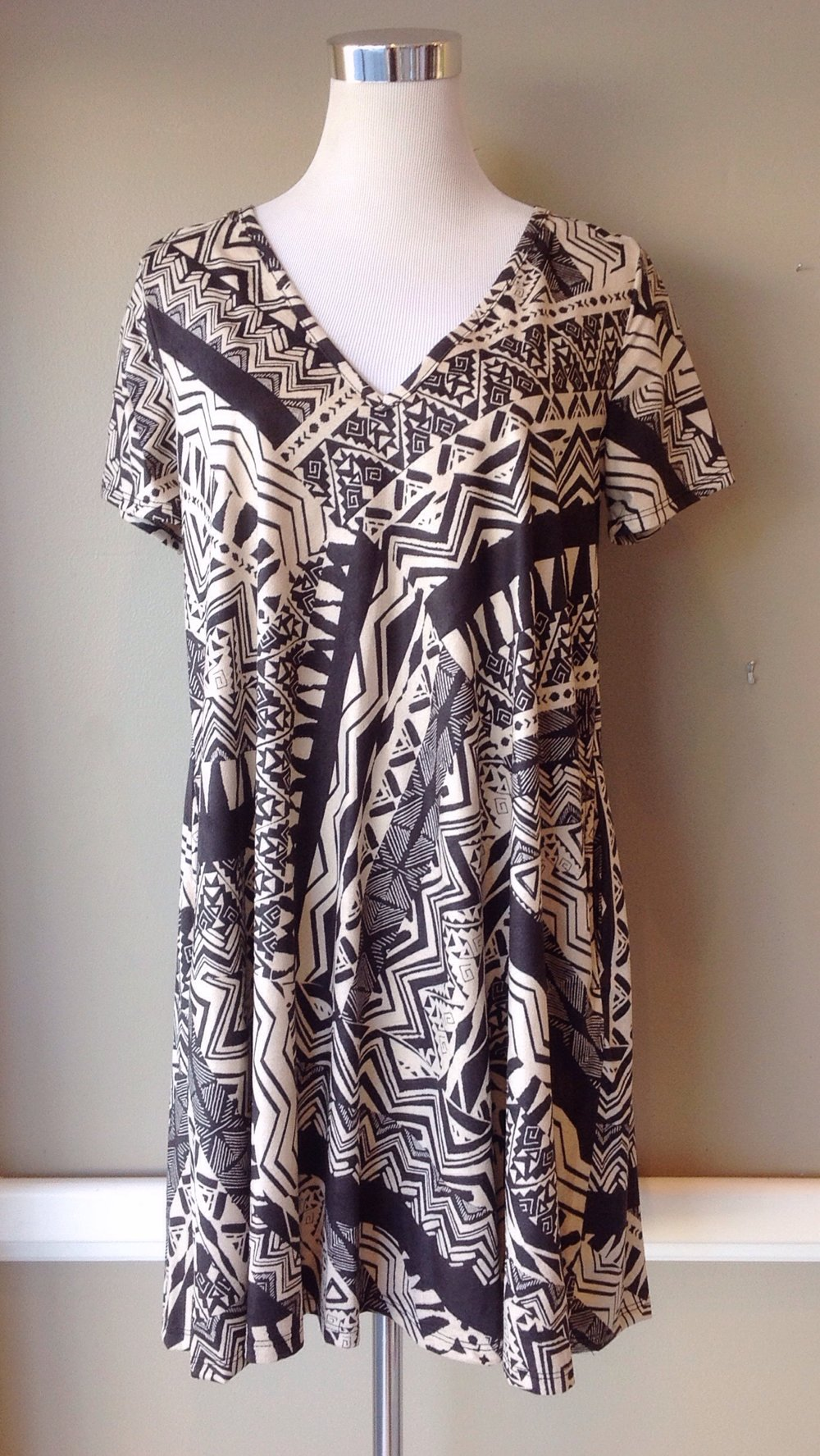 Woven swing dress with side pockets in taupe/brown, $38