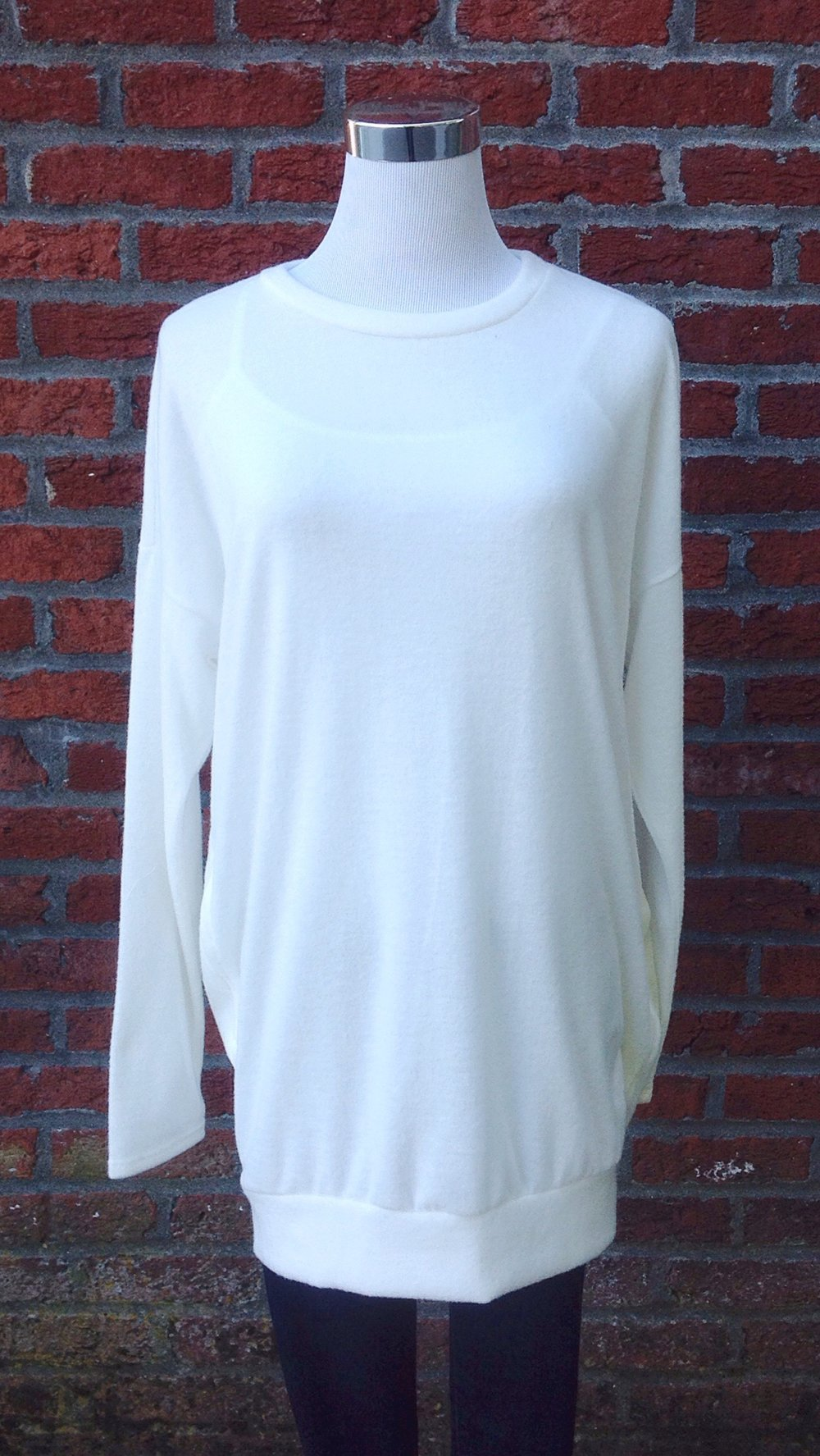 Ivory tunic sweater with side pockets n ivory, $34. Also available in olive and light grey.