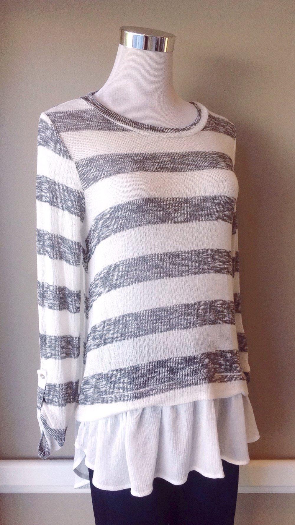 Boatneck stripe top with roll tab sleeves and layered hem in ivory/charcoal, $35