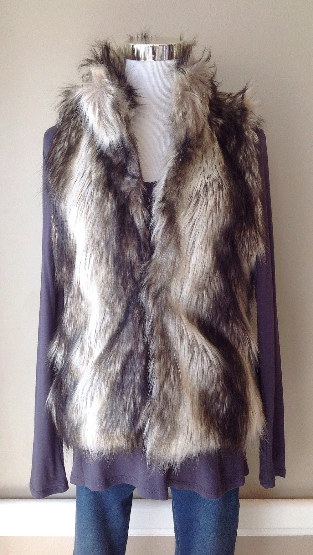 Faux fur vest with hidden hook and eye closures, $52