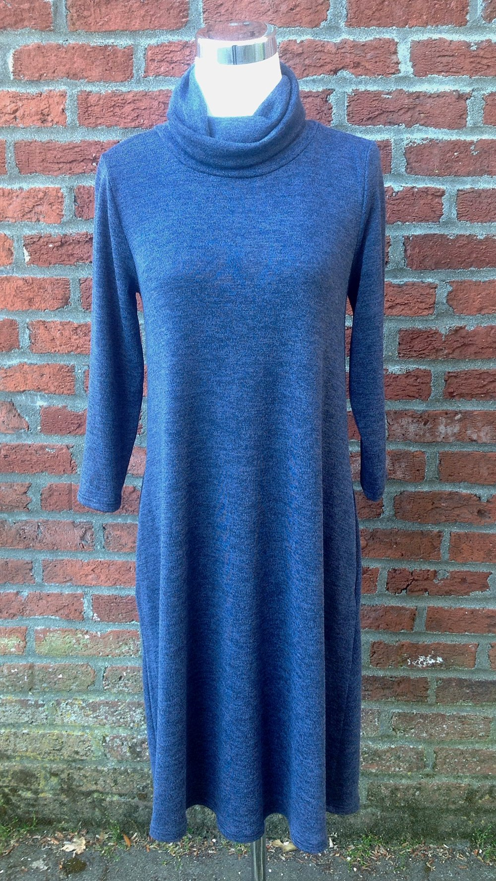 Two-tone navy sweater dress with turtleneck and side pockets, $38