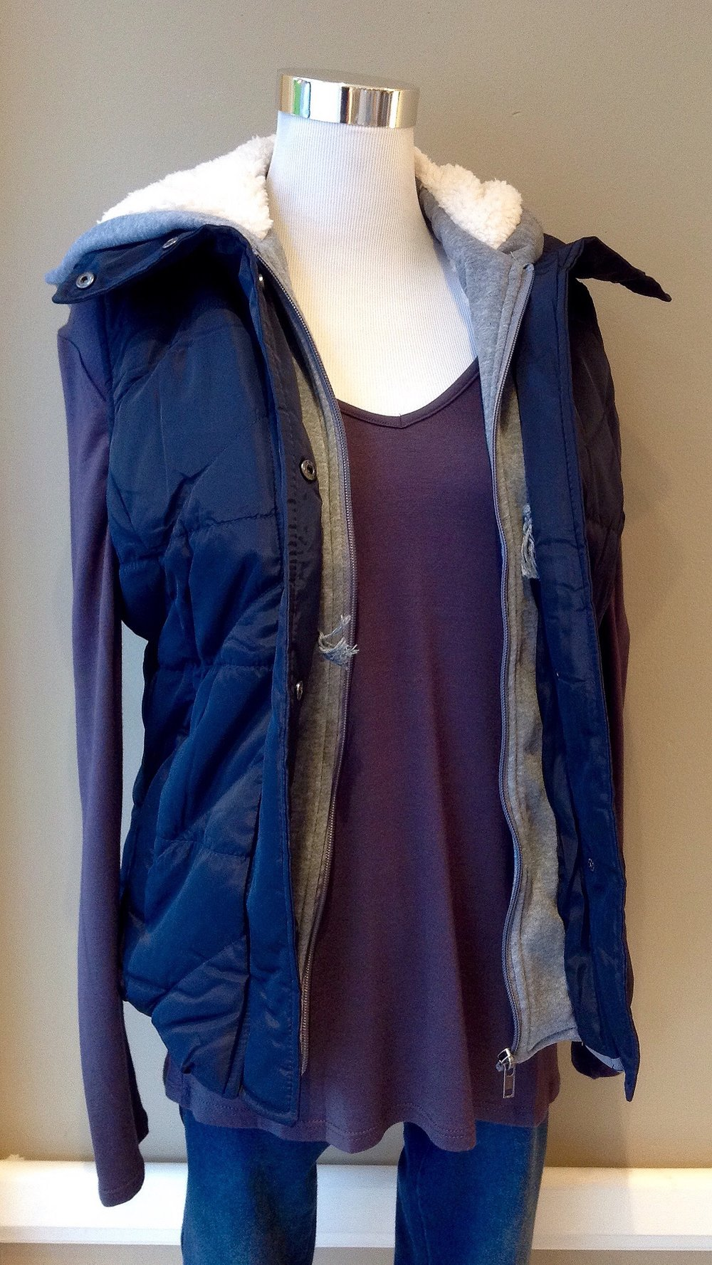 Zip and snap front puffer vest with shearling interior, $48