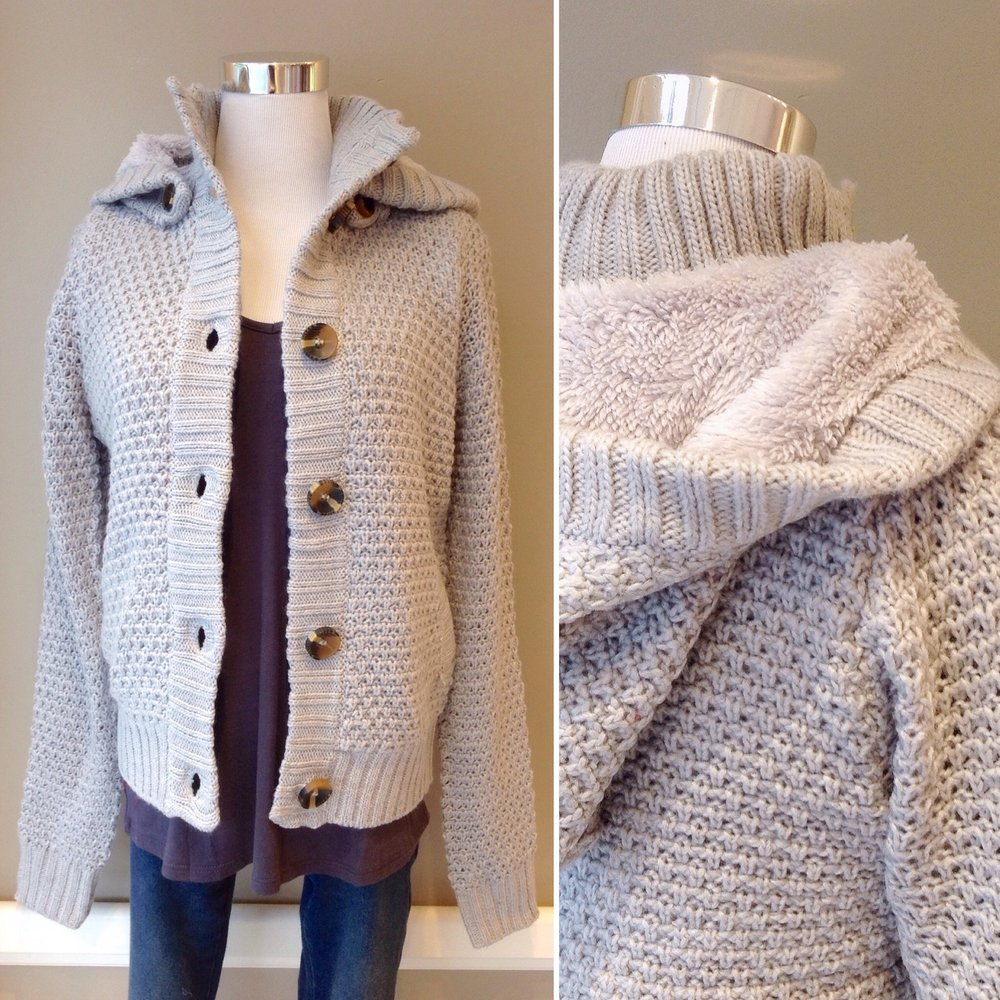 Chunky knit cardigan sweater with side pockets, removable hood and fleece interior, $48