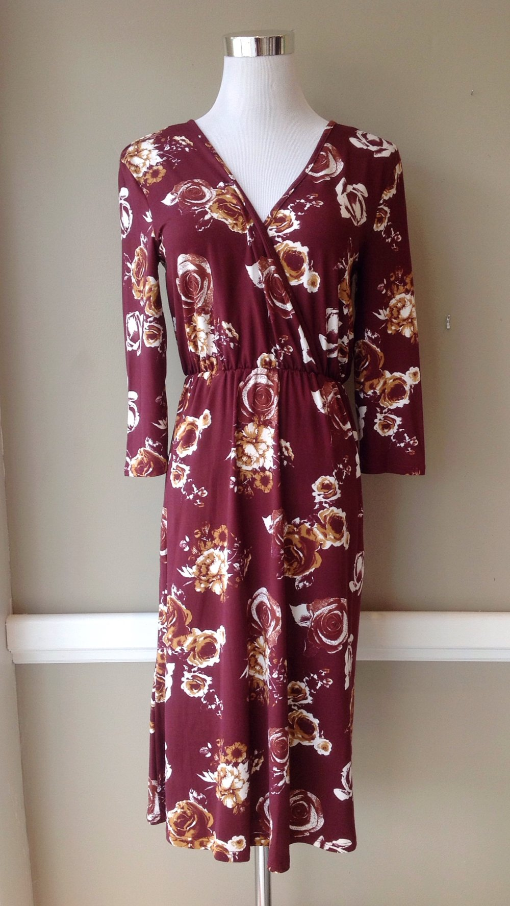 Burgundy floral midi dress with wrap front and 3/4 sleeves, $38