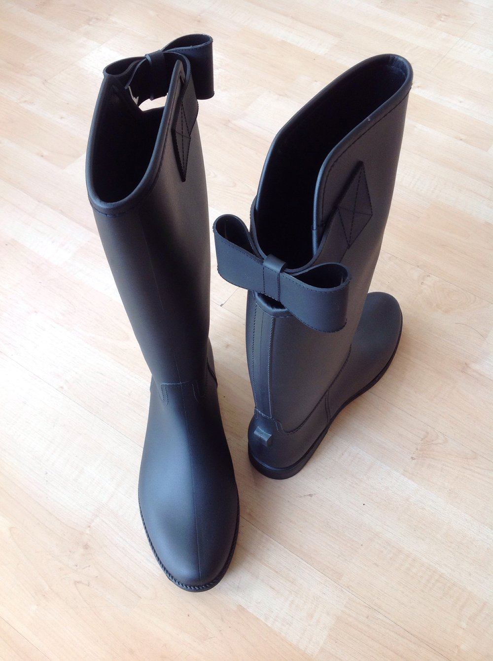 Tall black wellies with back bow, $38
