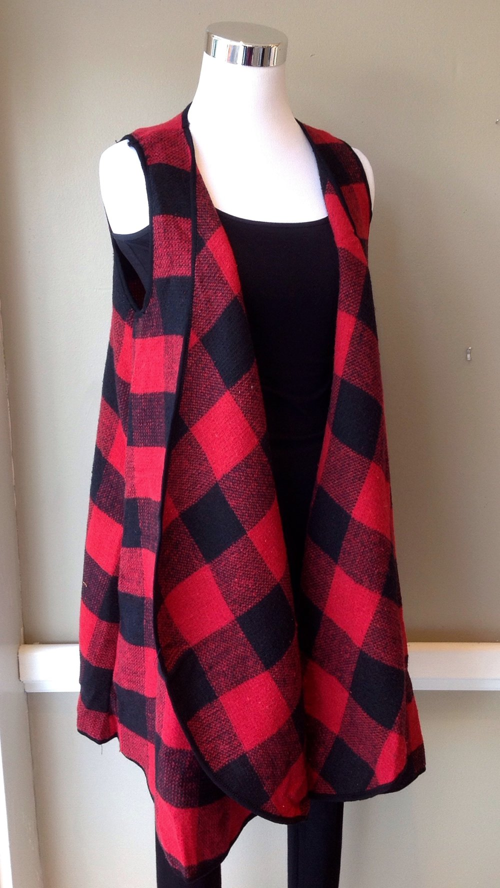 Red and black buffalo check vest with rounded hem and side seam pockets, $38