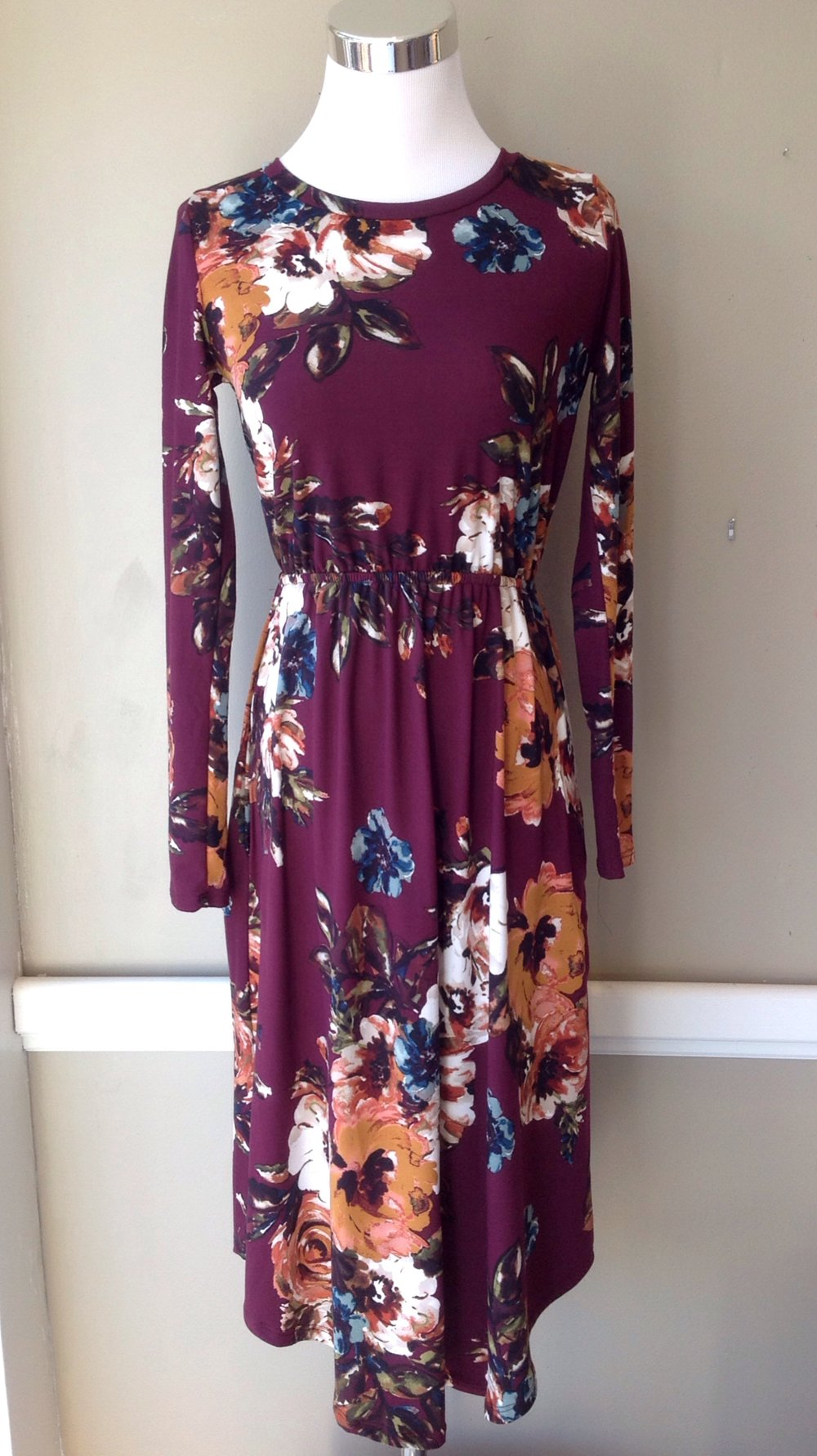 Floral knit midi dress with long sleeves, side seam pockets and rounded hem, $38. Available in wine/multi floral, black/multi floral, black with brown/red floral, and olive with taupe/wine floral.