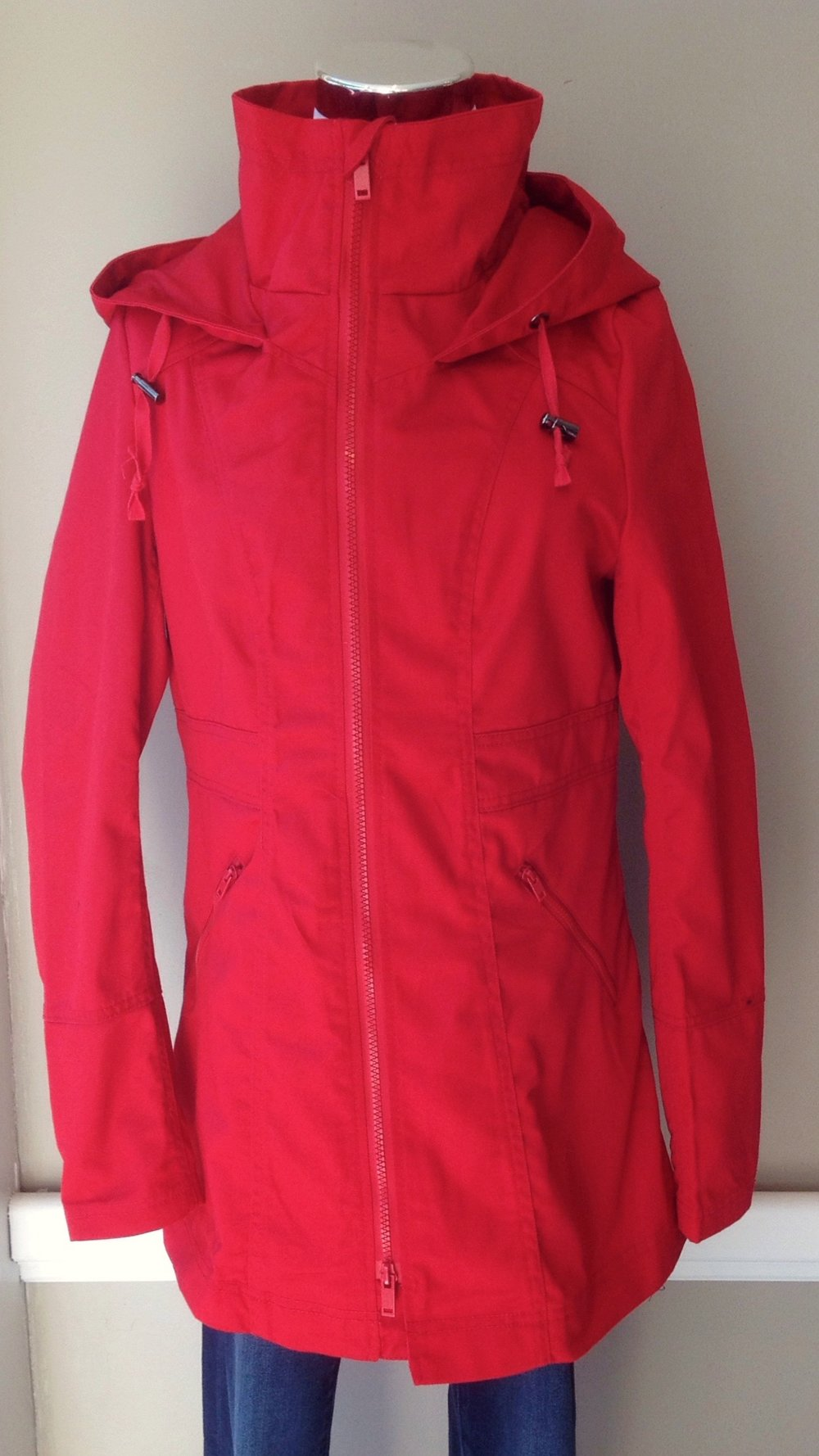 Water resistant utility jacket with high collar, hood and cinched back waist, $48