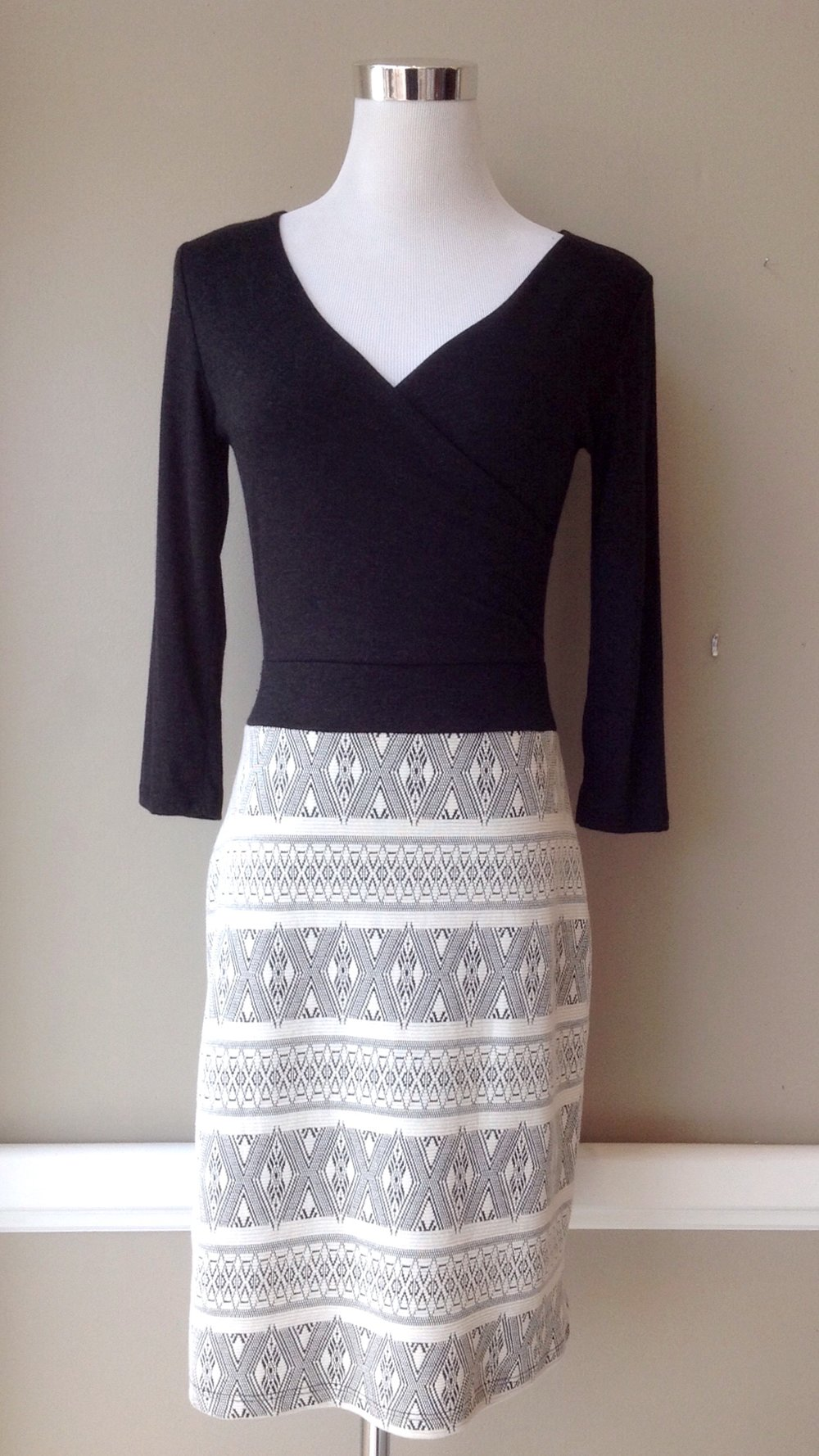 Wrap style dress with contrasting knit skirt and 3/4 sleeves, $45