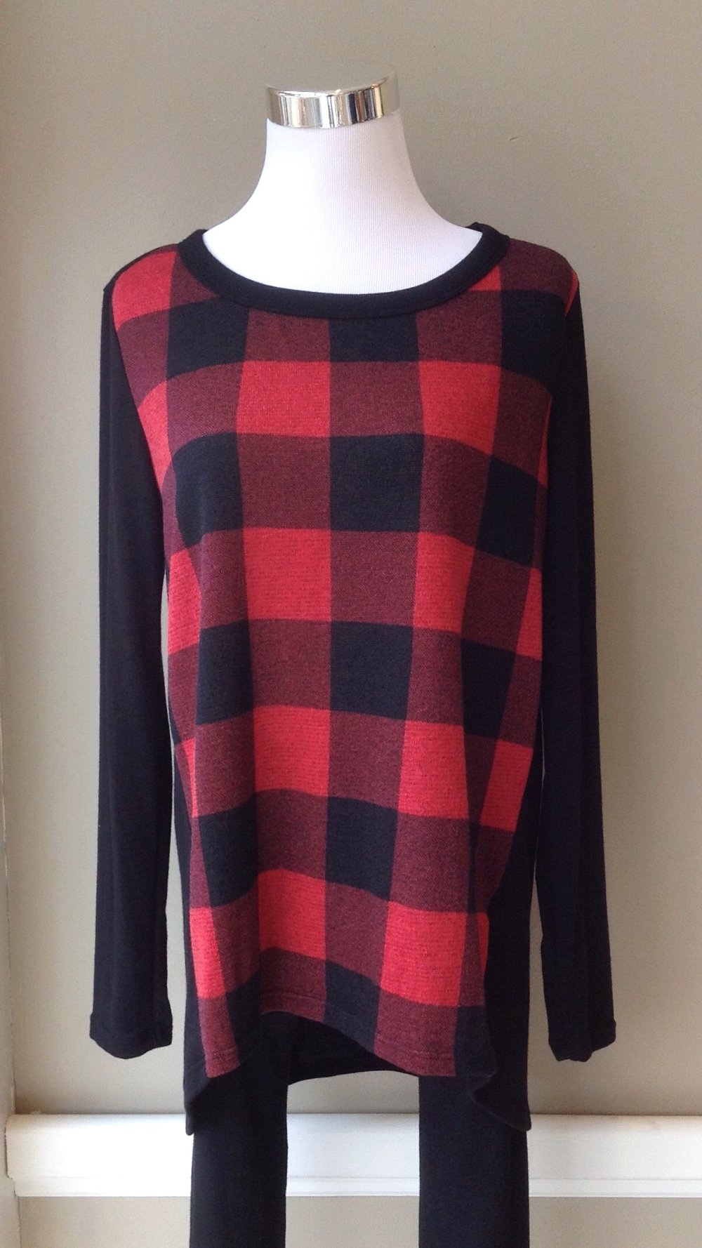 Buffalo check top with high-low hem and solid black knit sleeves, $32.  Low stock but more on the way!