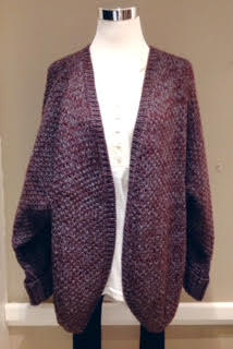 Chunky two-toned cardigan with rounded hem in burgundy, $52