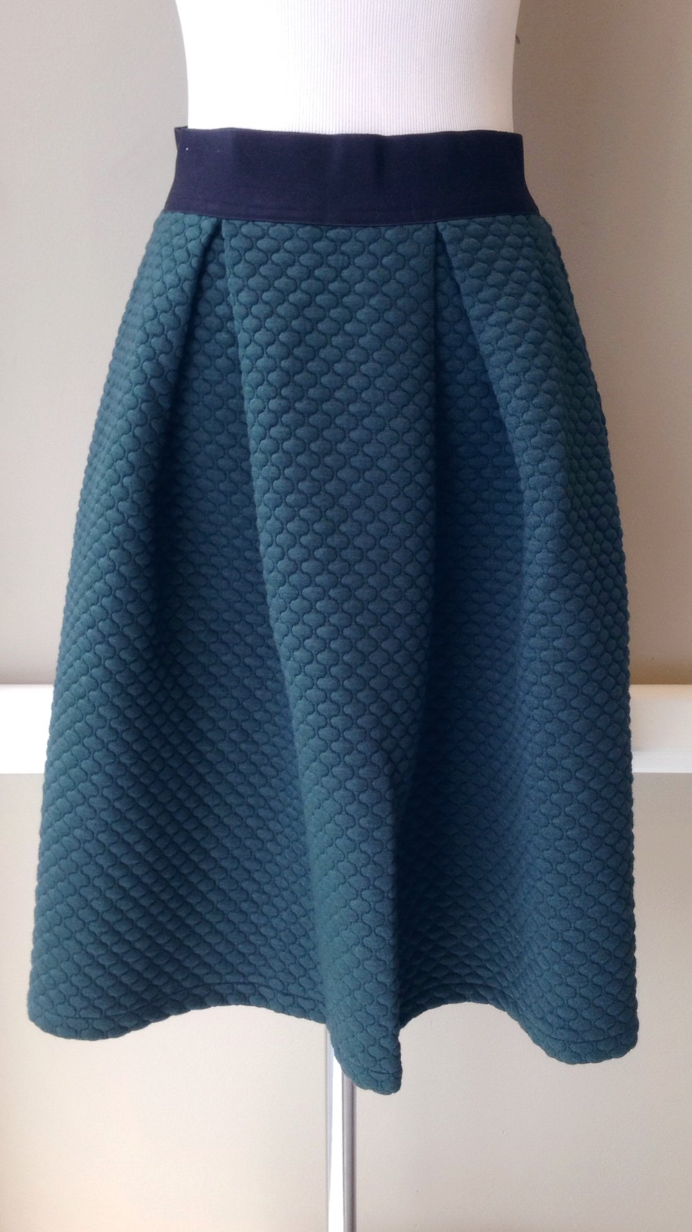 Textured knit skirt with inverted pleats and elastic waistband in hunter green, $38