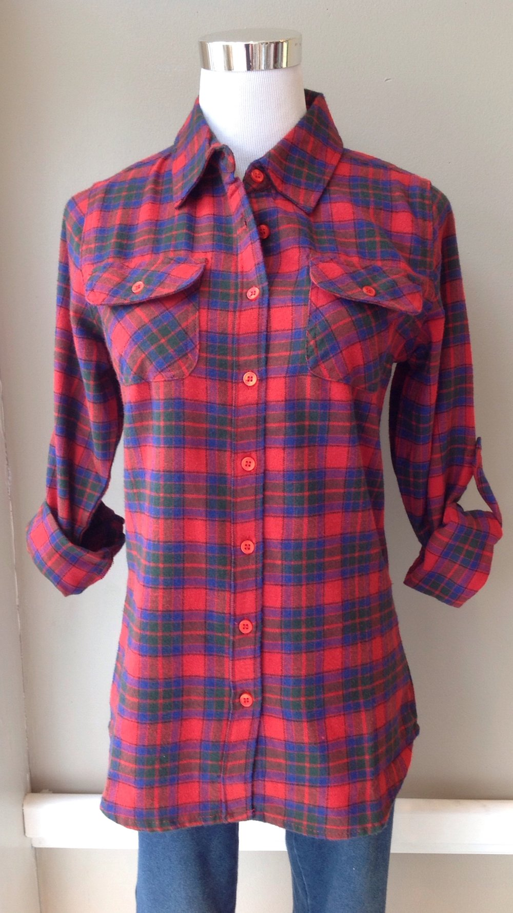 Cotton flannel button-down top with roll tab sleeves in red/royal plaid, $34