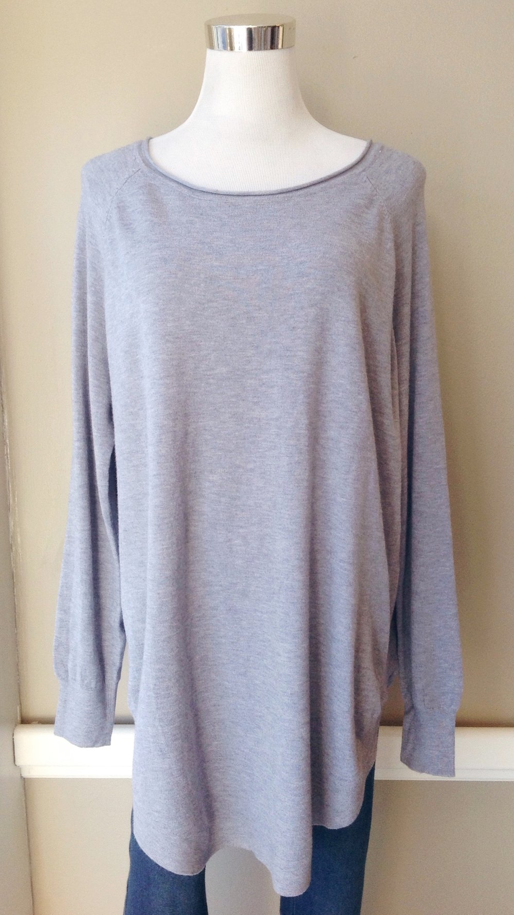 Ultra soft oversized sweater with rounded hem in dust blue, $40