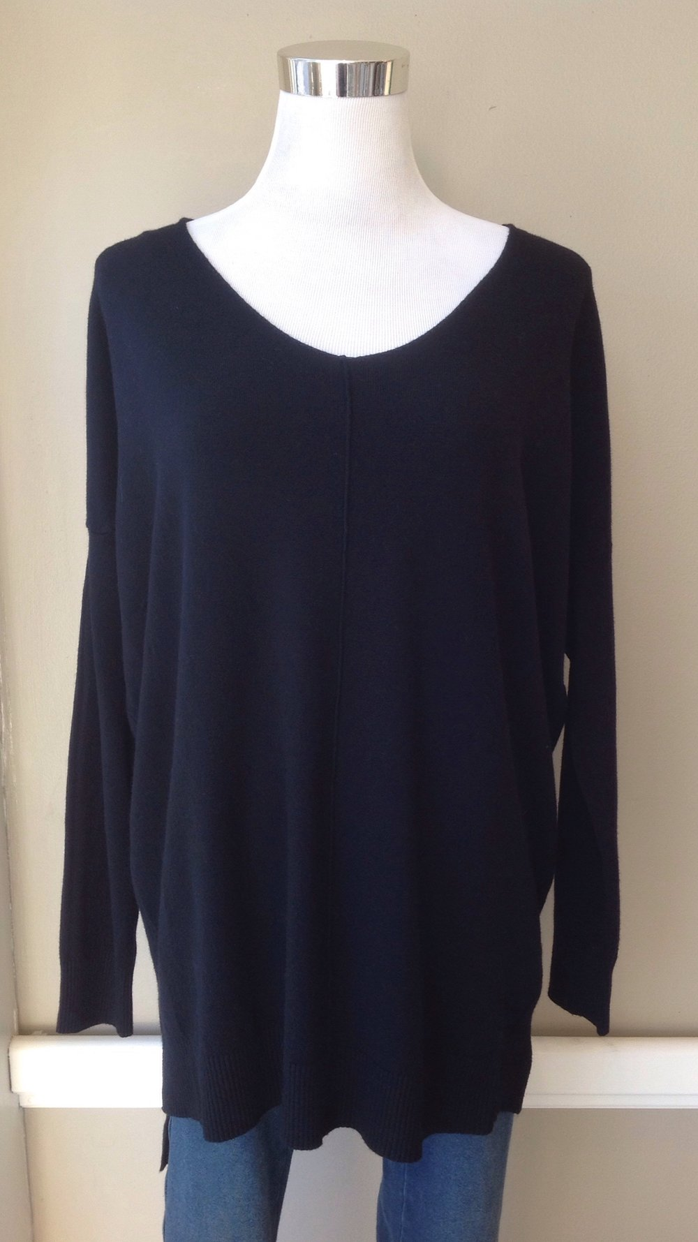 Ultra soft v-neck sweater with center seam and tiered hem in black, $40