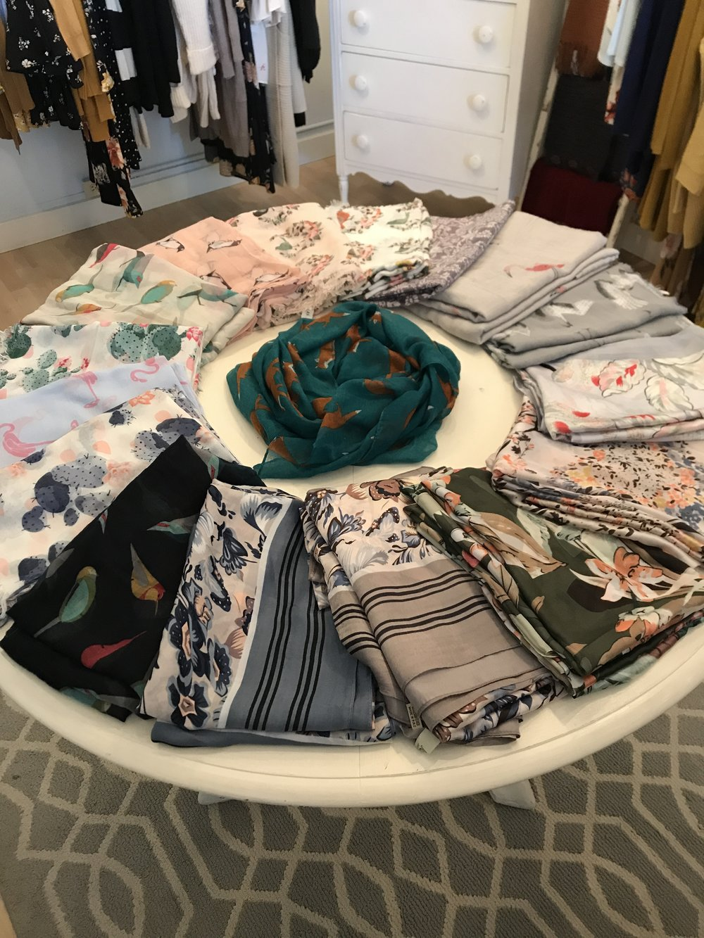 Come peruse the plethora of scarves! From penguins to foxes to flamingos and florals, the scarf table has the perfect accent to take any outfit to the next level.