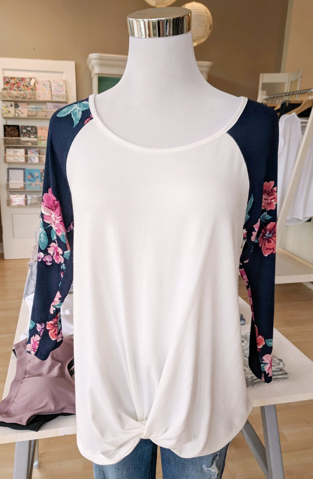 Scoop neck twist top with floral sleeve $35