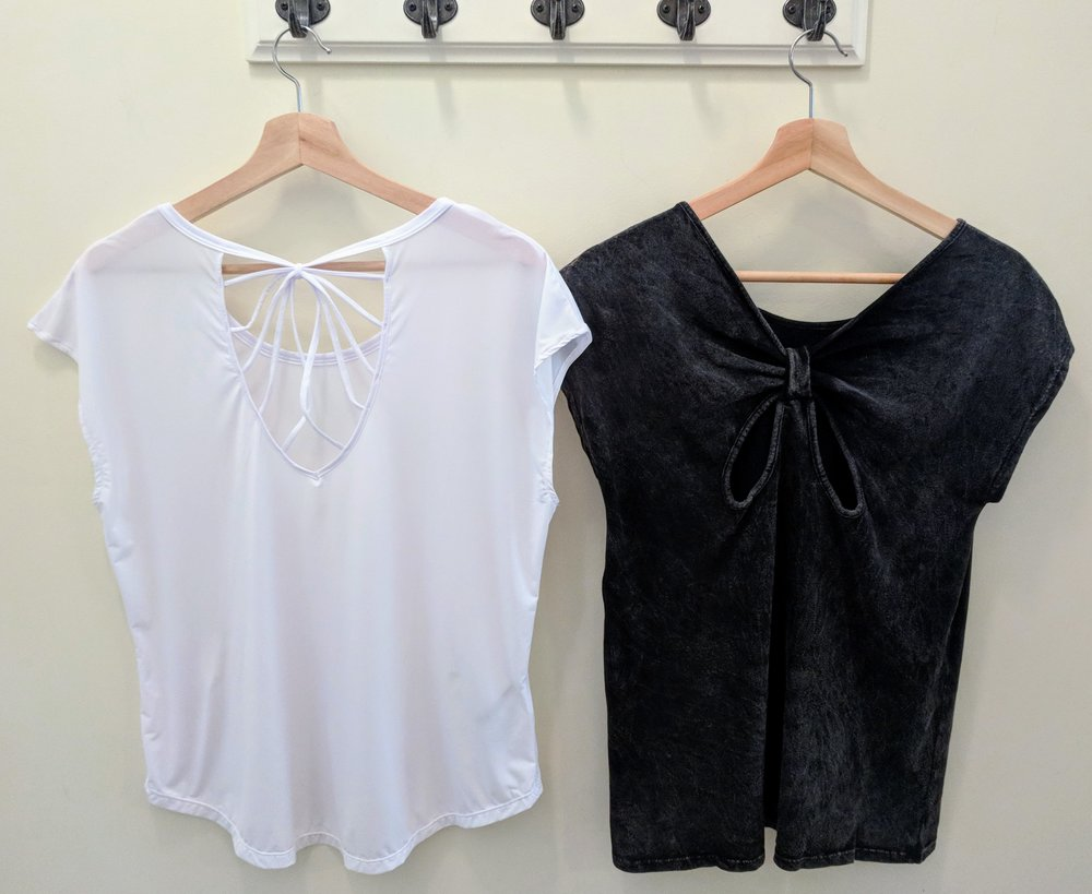 White strappy back active top $28, Charcoal butterfly tie-back active top $28