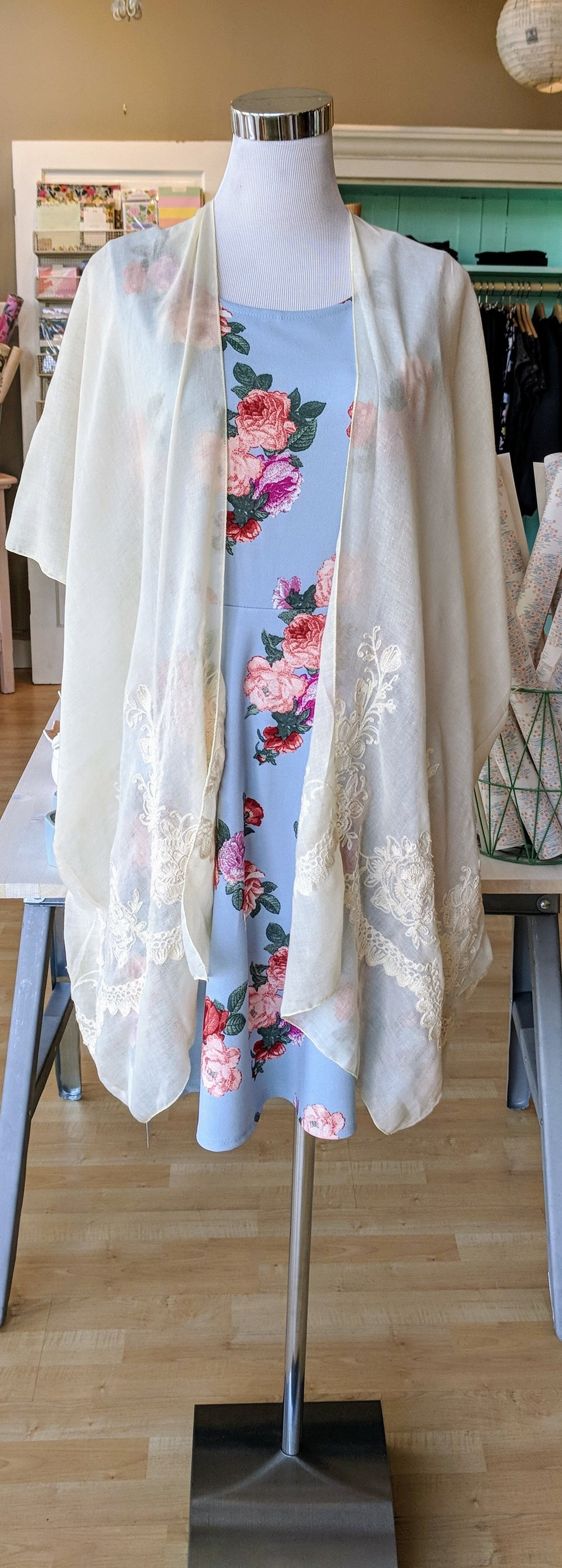Ivory Kimono with embroidered floral blooms along bottom. $24