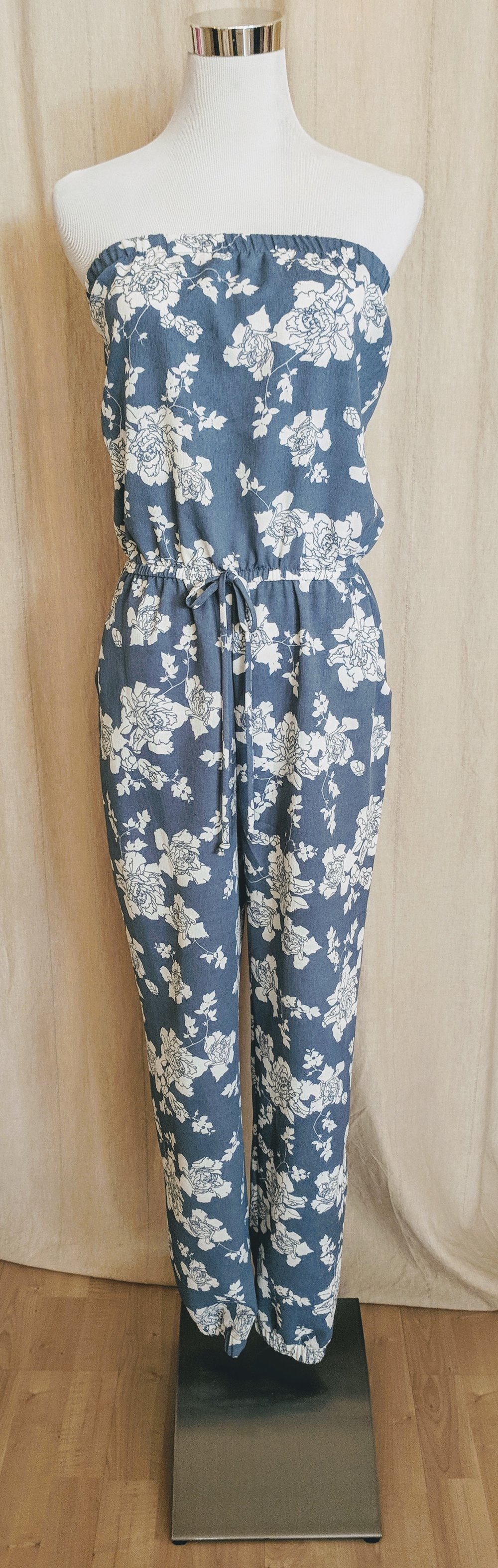 Light blue strapless Jumpsuit with pockets.