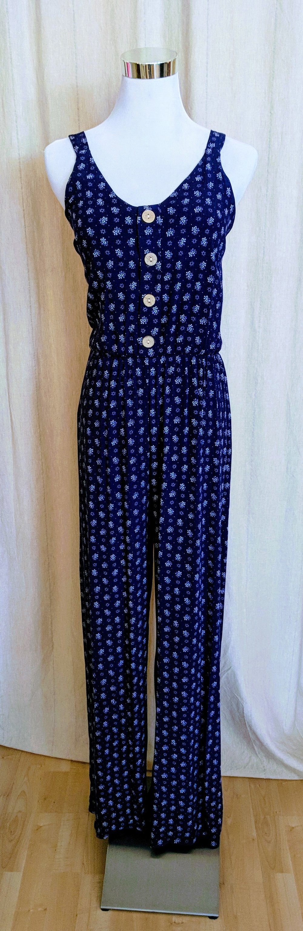Navy jumpsuit with tie detail on back.