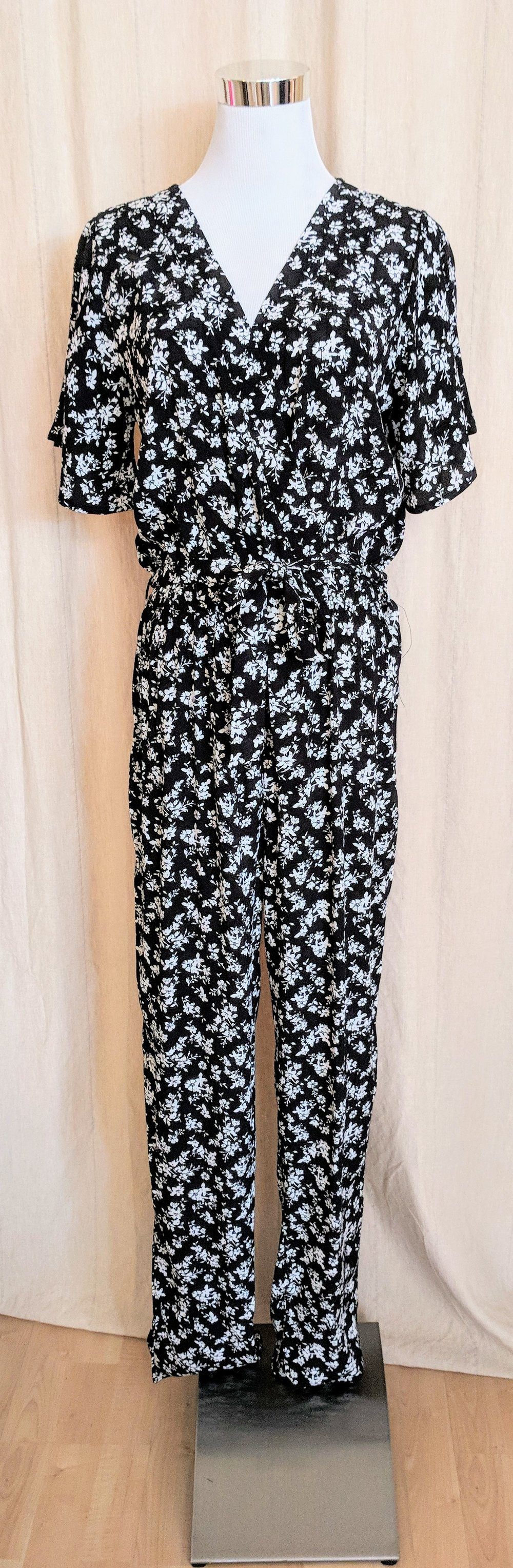 Black and Ivory floral jumpsuit with waist tie detail.