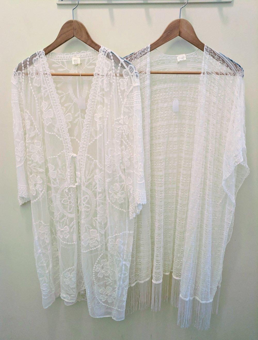White lace kimono with front tie. White lace kimono with tassel trim.