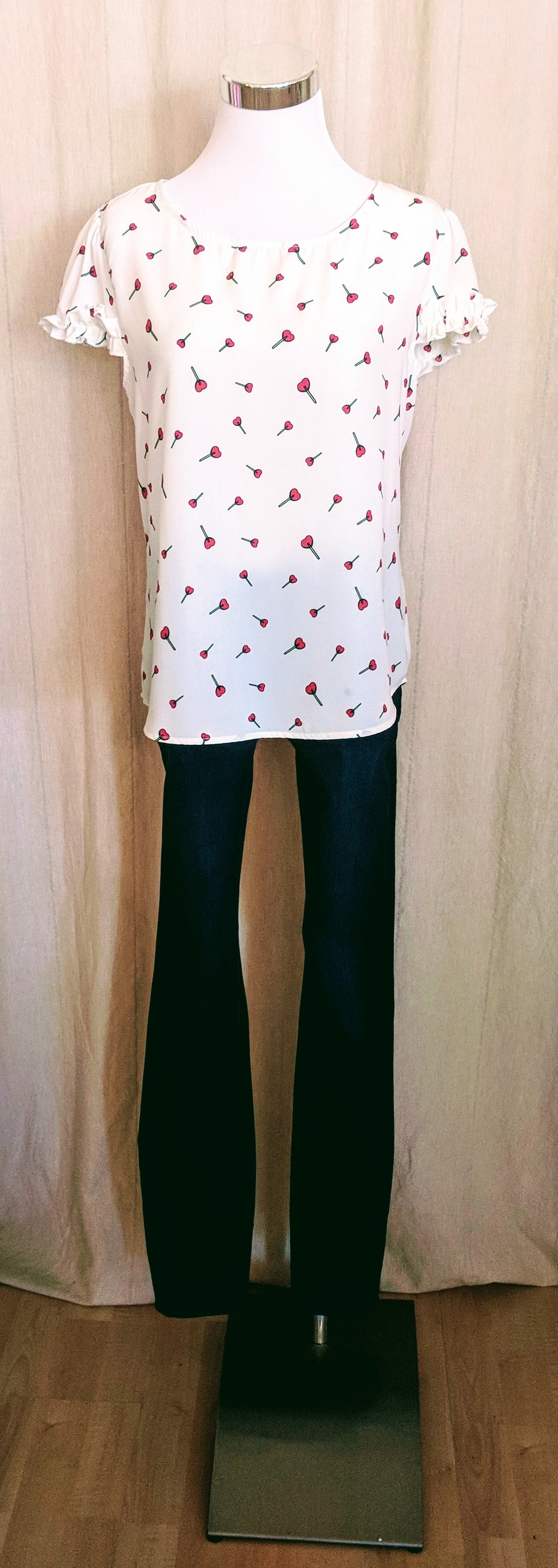 White w/ hearts flutter sleeve top.