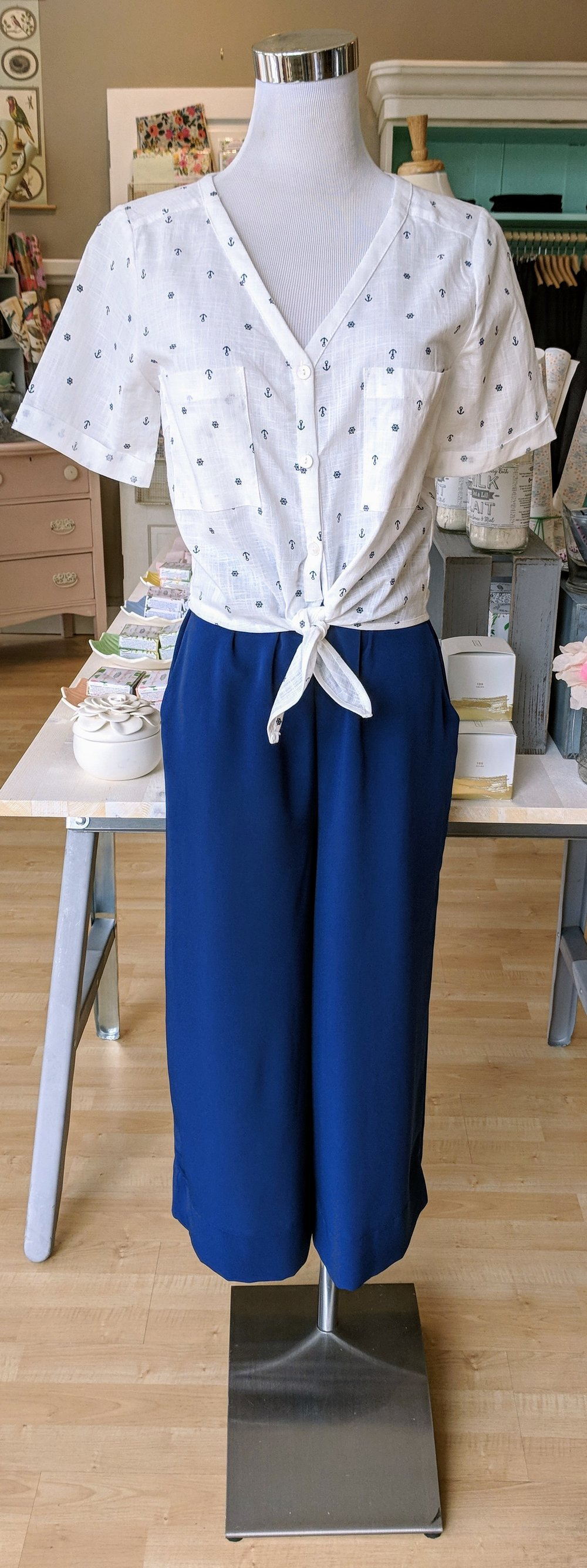 Blue culotte pant with white anchor print crop top.
