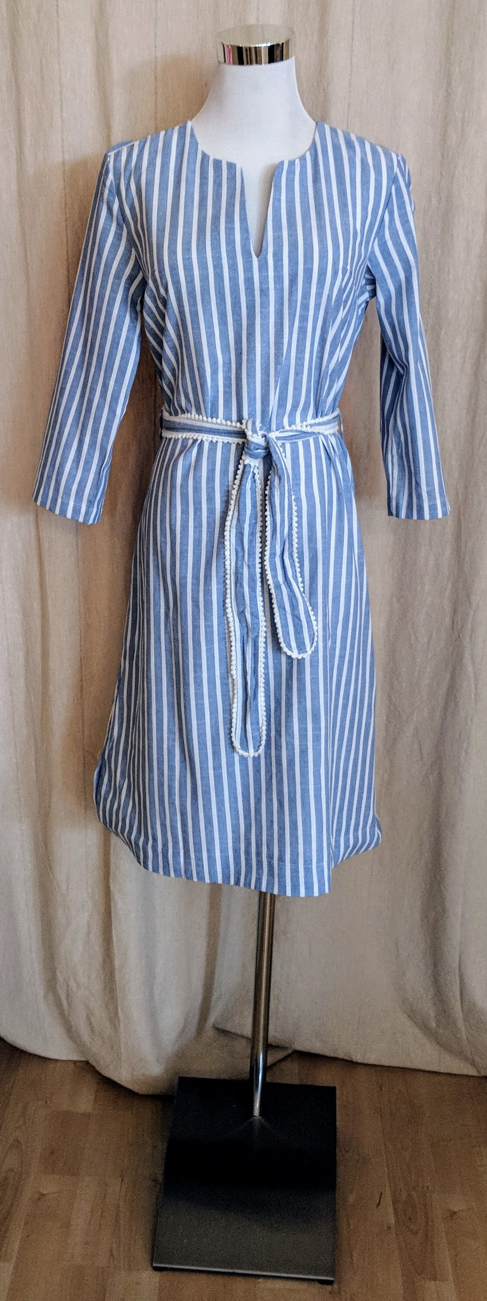 Blue stripe flare dress with boat neckline.