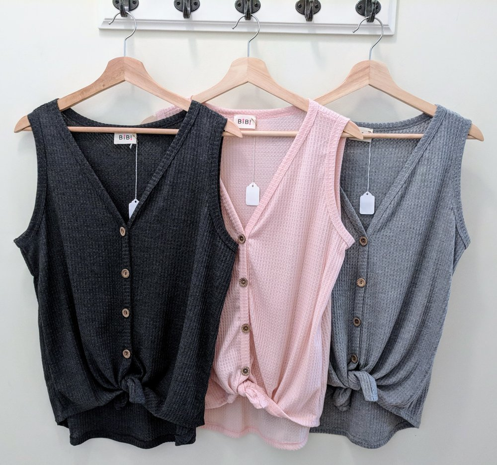 Sleeveless knit top with tie front. Heather grey, Charcoal and Blush.