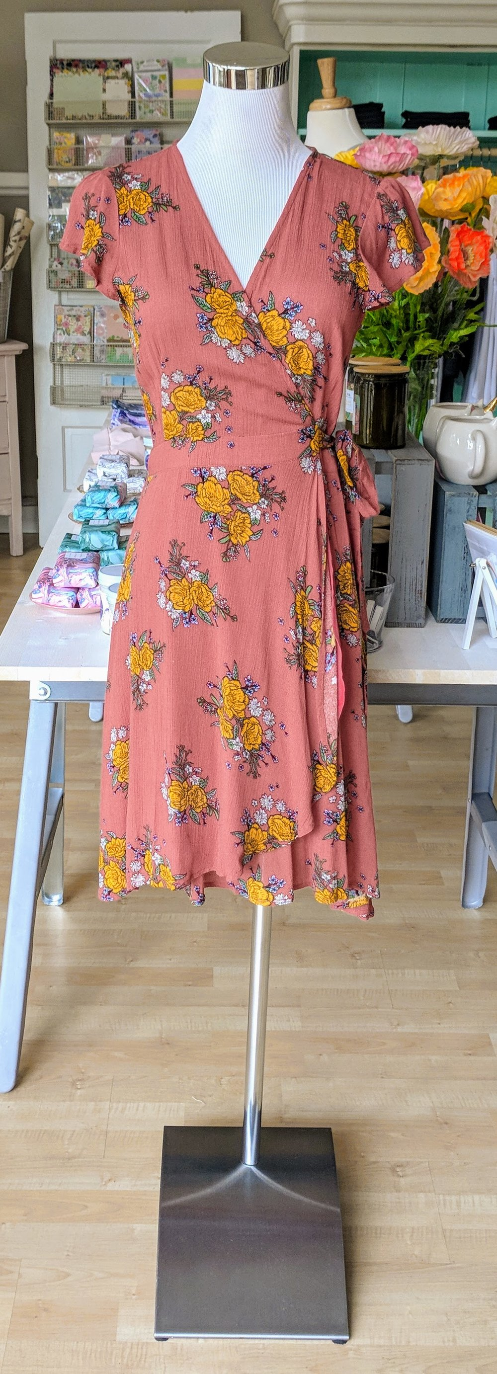 Coral floral print wrap dress.