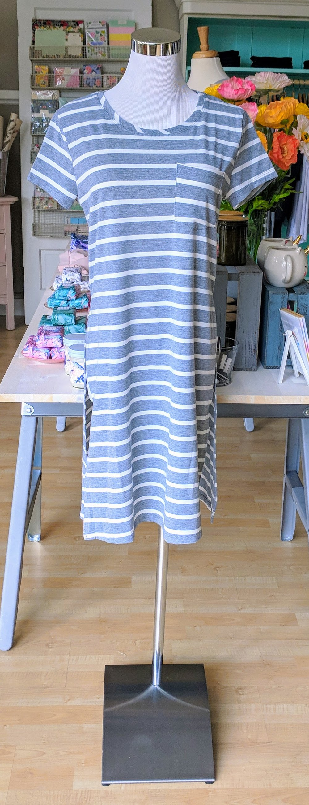 Grey stripe top with pocket detail and side slit.