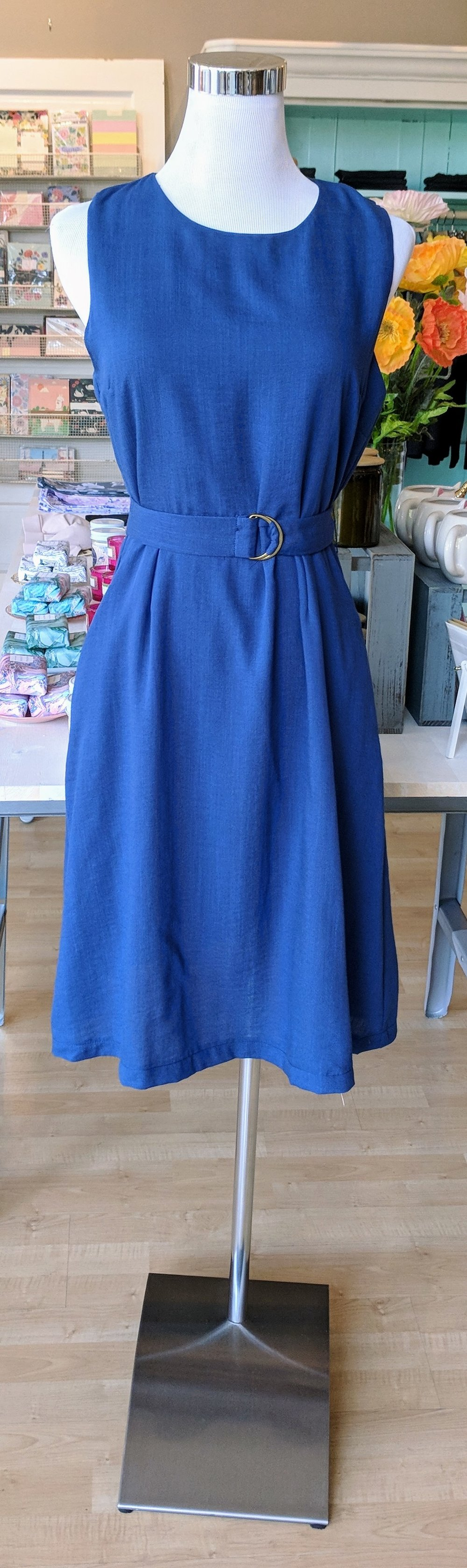 Blue midi dress with belt.