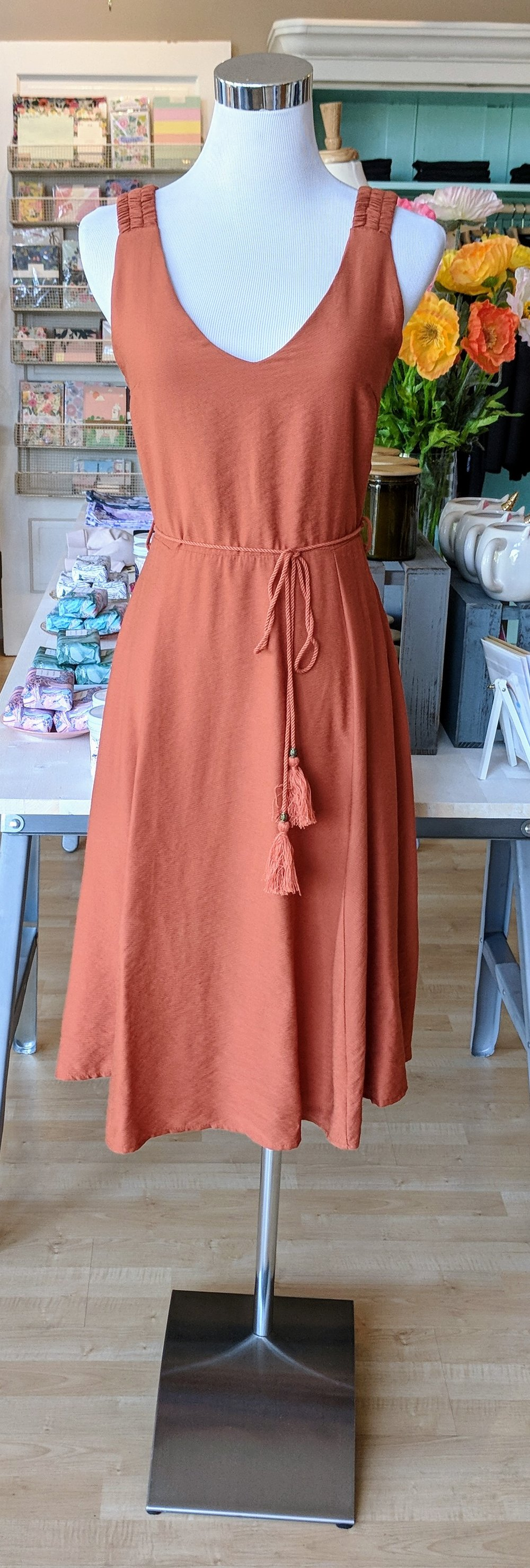 Rust woven dress with front tie.