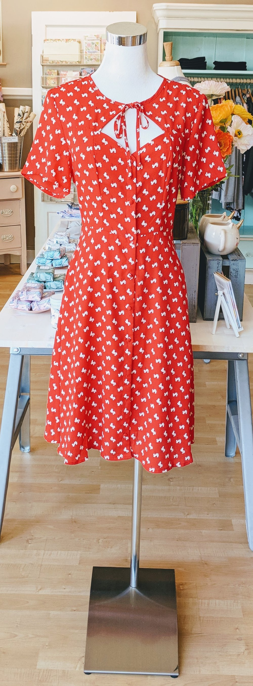 Red pattern dress with buttons and key hole detail with tie.