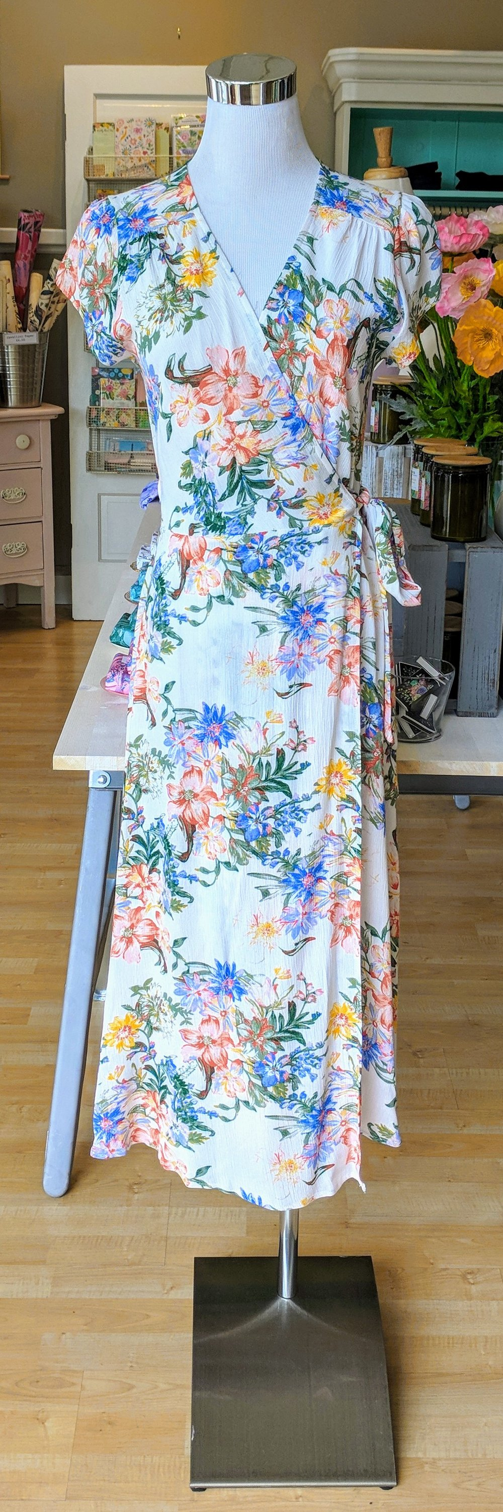 Ivory floral wrap dress with cap sleeve.