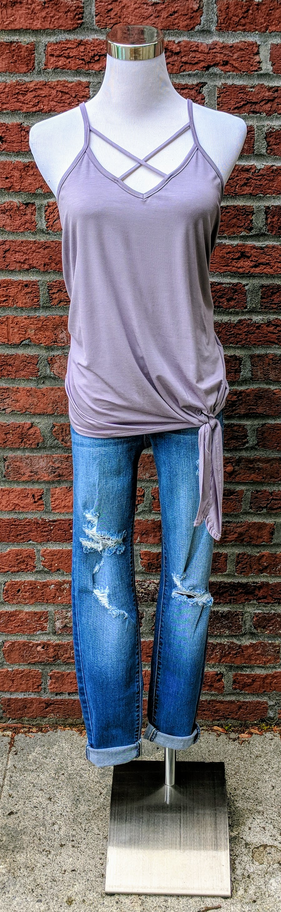 Lavender knit tank with x-strap and knotted hem.