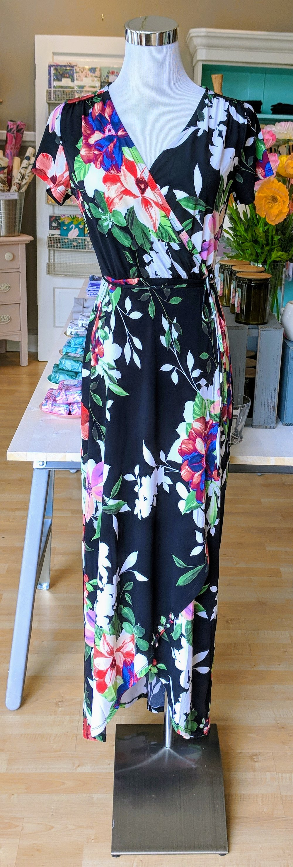 Black floral maxi dress with an overlapped waist.