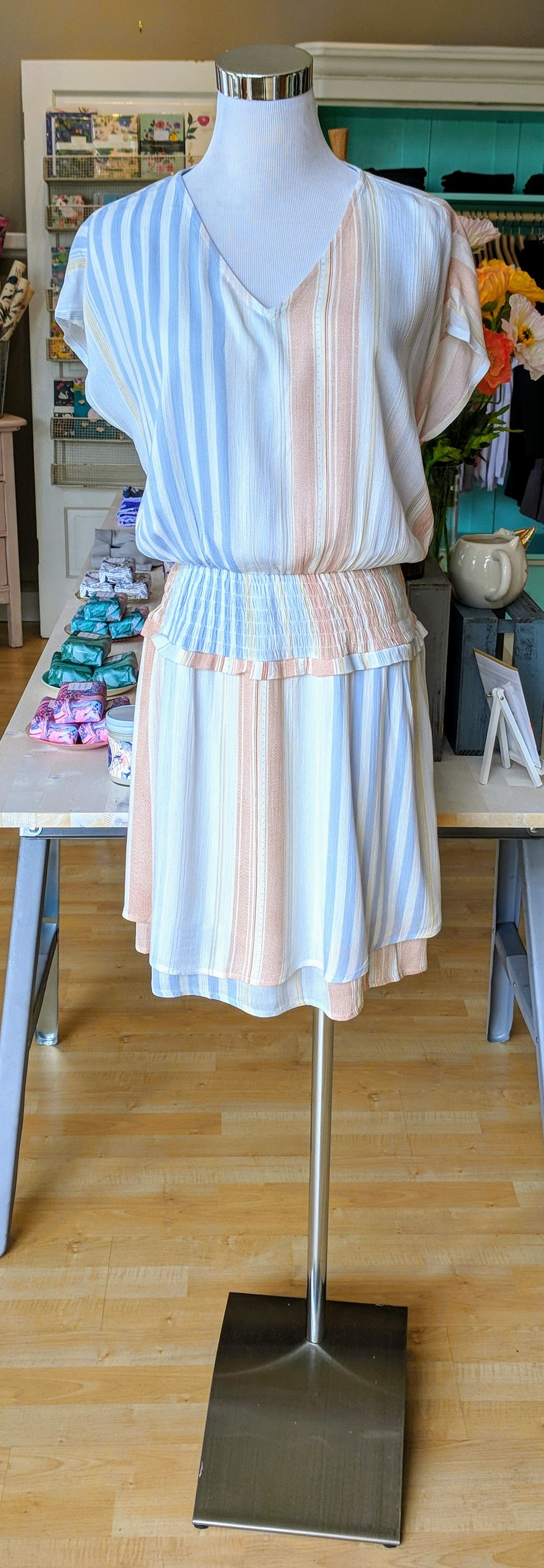 Light blue striped mini dress with a smocked waist.