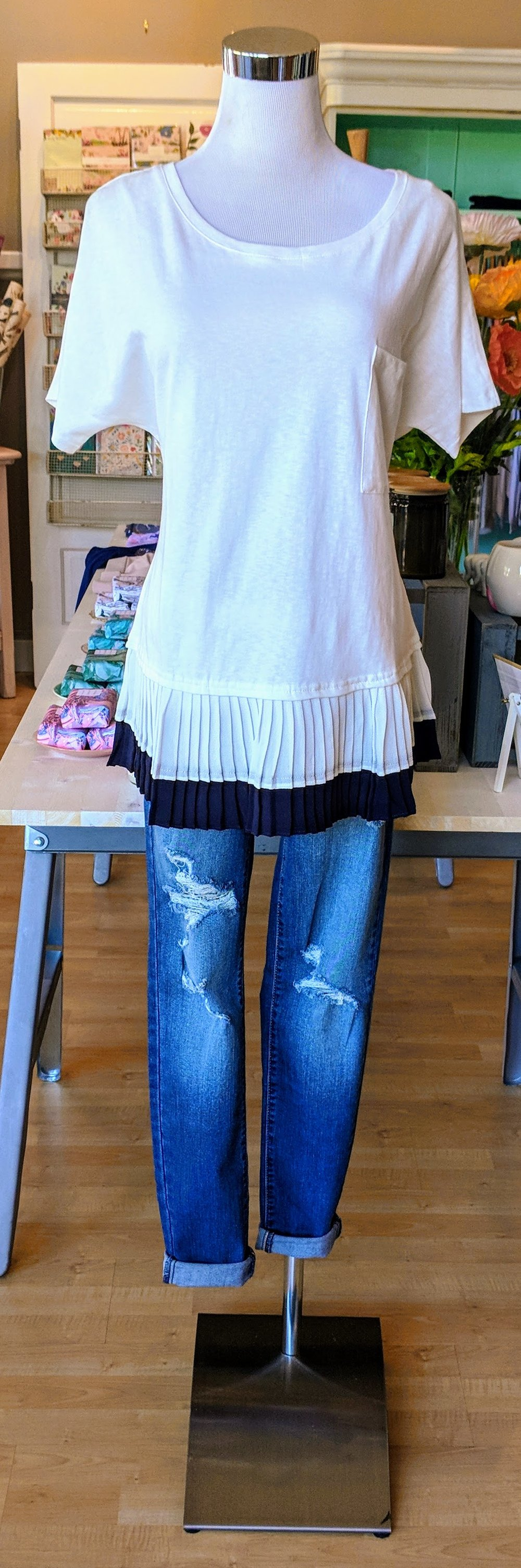 White top with pleated navy bottom