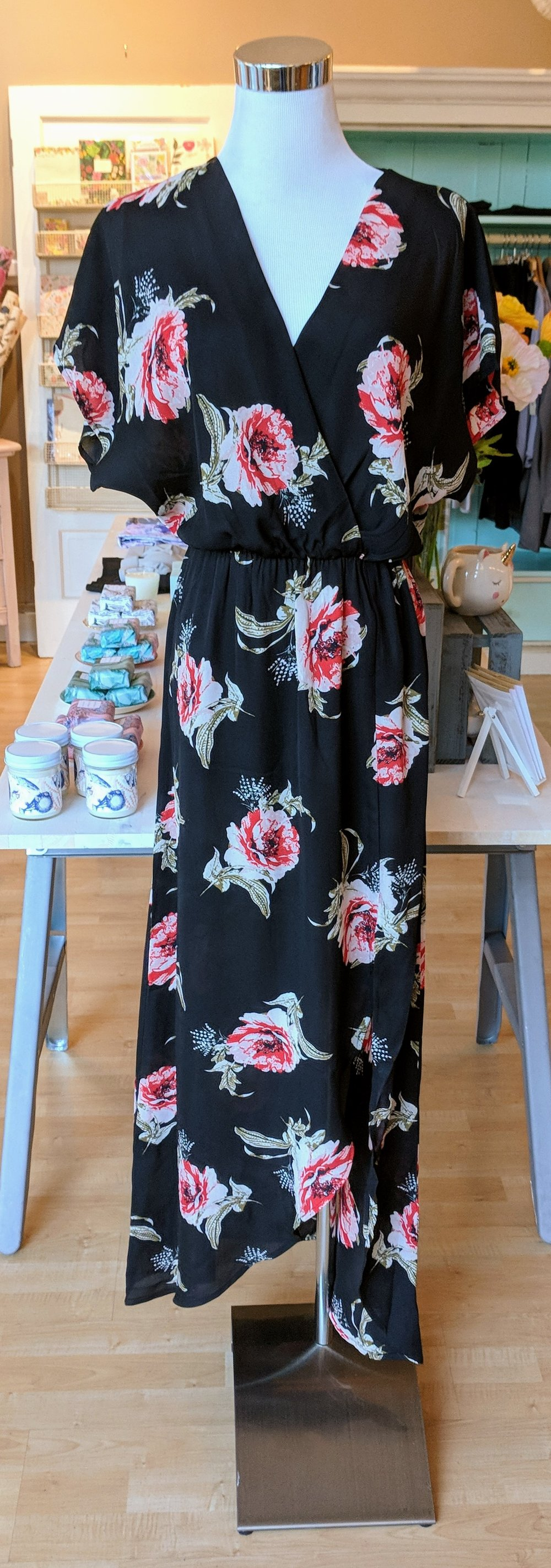 Black floral wrap dress with dolman sleeve.