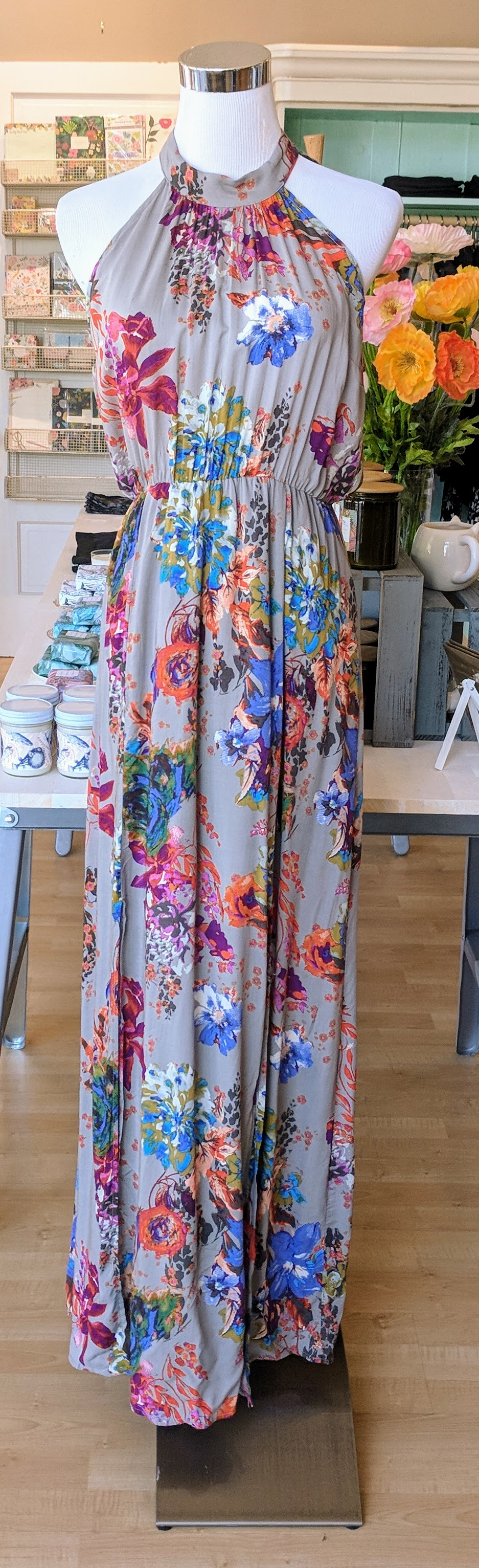 Heather Grey floral print maxi dress with side slits and a tie neck.