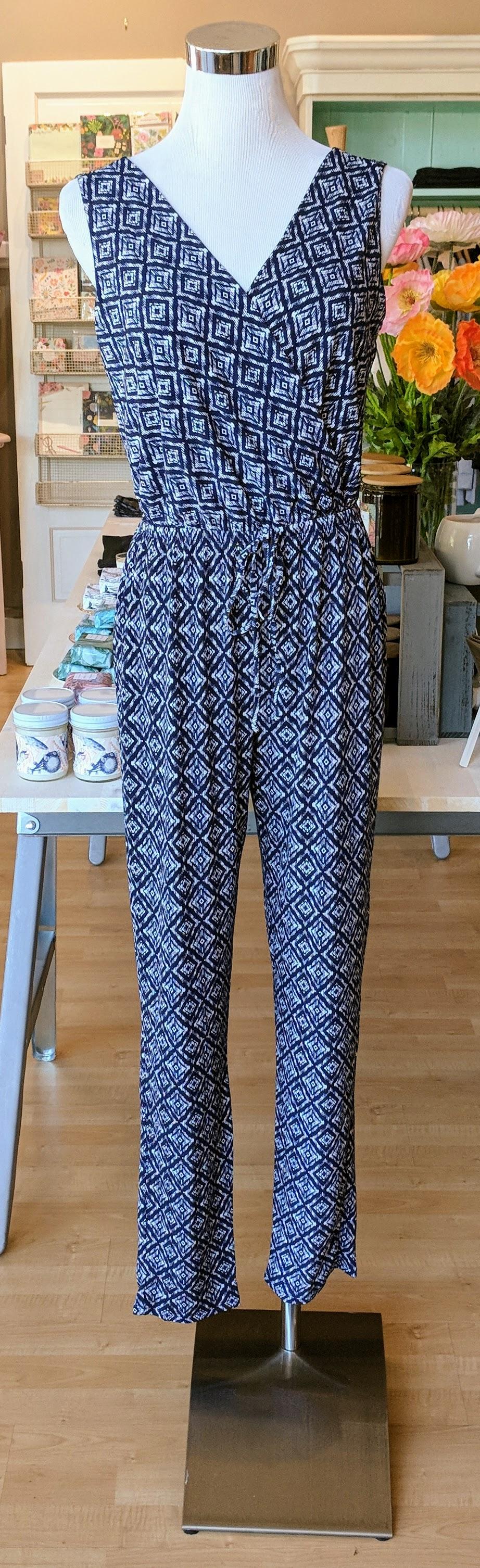 Navy diamond print jumpsuit with tie waist.