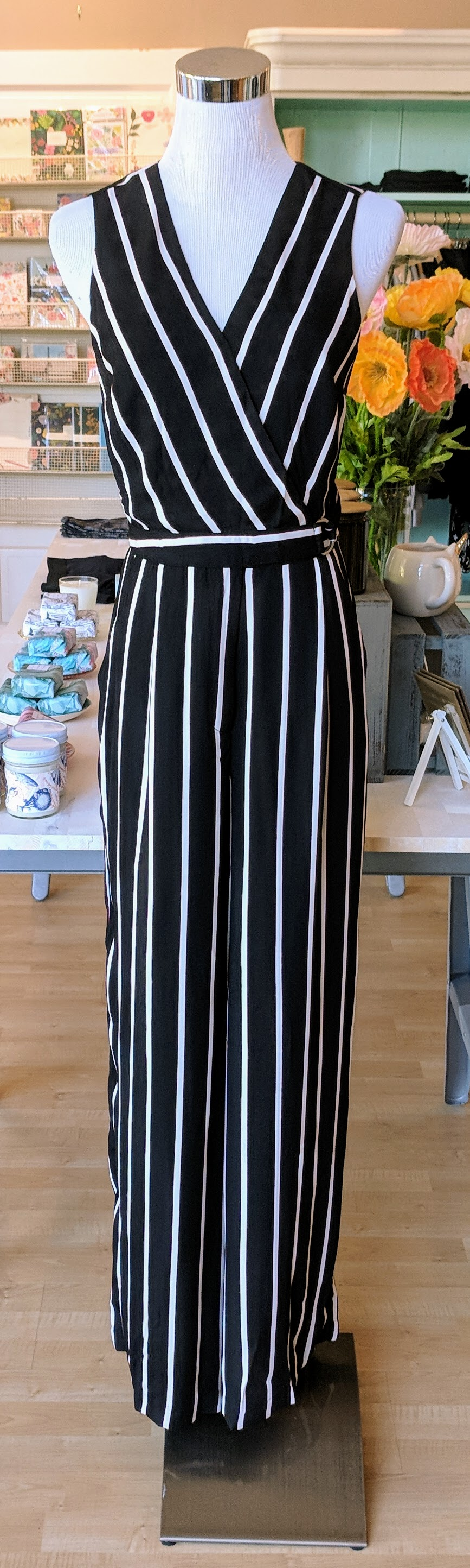 Black and Burgundy stripe wrap jumpsuit with belt detail.