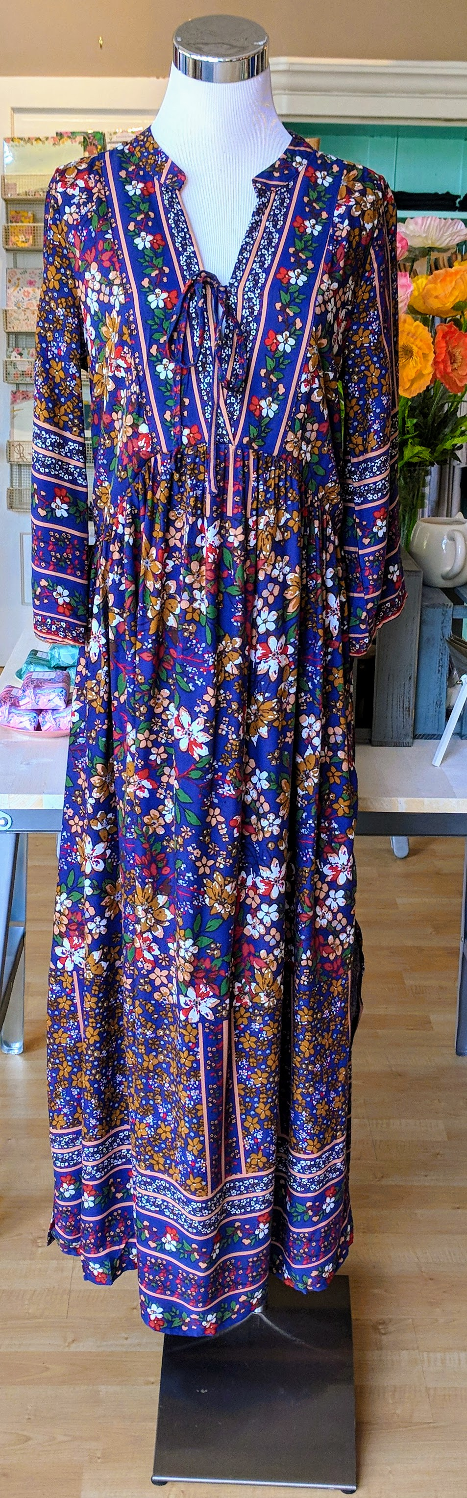 Blue pattern maxi smock dress with tie neck and 3/4 sleeve.