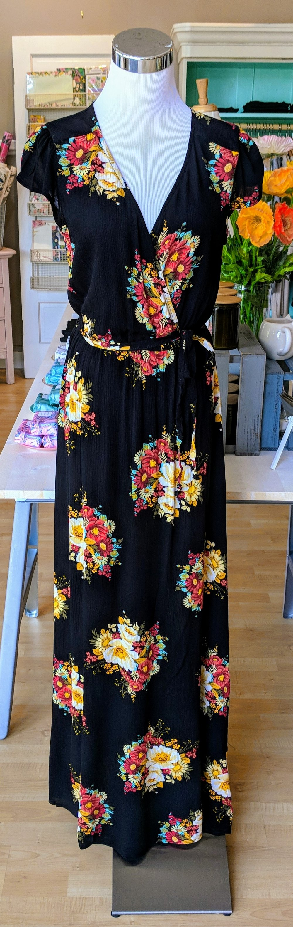 Black floral pattern maxi wrap dress with tie waist.